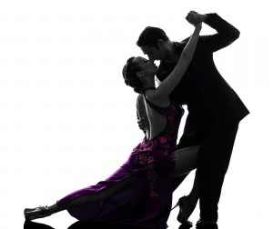 one caucasian couple man woman ballroom dancers tangoing in sil