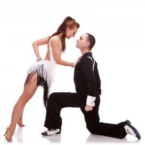 woman dancer leaning against her dance partner, in a sensual pos